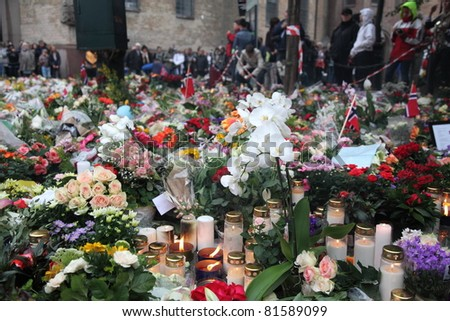 OSLO, NORWAY - JULY 24 : Candles and flowers for Norway victims near explosion site at Domkirken church on July 24, 2011 in Oslo