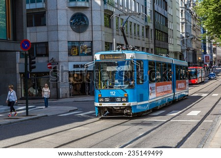 OSLO, NORWAY - JULY 29: Modern blue city tram in Oslo, Norway on July 29, 2014