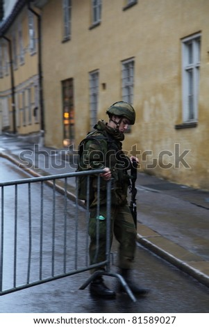 OSLO, NORWAY - JULY 24 : Norwegian soldier closes the gate on a street where explosion happened on July 24, 2011 in Oslo - stock photo