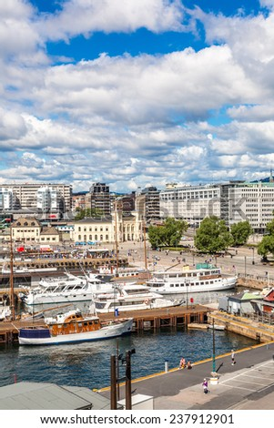 OSLO, NORWAY - JULY 29: The Oslo Norway Harbor is one of Oslo's great attractions. Situated on the Oslo Fjord in Oslo, Norway on July 29, 2014 - stock photo