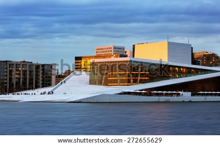 OSLO, NORWAY - JUNY 1: National Oslo Opera House shines at sunrise on Juny 1, 2014. Oslo Opera House was opened on April 12, 2008 in Oslo, Norway - stock photo