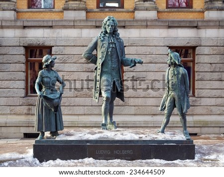 OSLO, NORWAY - MARCH 7, 2011: Ludvig Holberg Monument outside the National Theatre. Ludvig Holberg (1684-1754) was a writer which considered the founder of modern Danish and Norwegian literature. - stock photo
