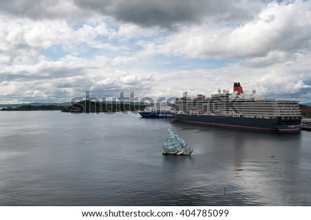 "OSLO, NORWAY - MAY 13, 2014: Cunard cruise ship ""Queen Elizabeth"" docked in the port of Oslo. View from Opera House. Oslo, Norway, Europe."