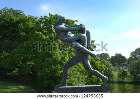 OSLO, NORWAY - May 28: sculpture of a man holding a girl who resists in Vigeland park in Oslo, Norway on May 28, 2008. installed in park 212 bronze and granite sculptures created by Gustav Vigeland.
