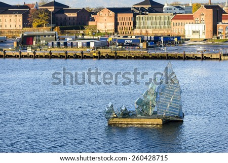 """OSLO, NORWAY-OCTOBER 25, 2014: The floating sculpture in front of the Oslo Opera House, namely """"She Lies"""", created by italian artist Monica Bonvicini. It made from steel and glass. - stock photo"""