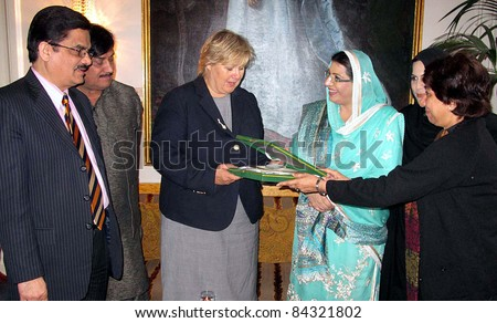 OSLO, NORWAY - SEPT 08: Federal Minister for Information and Broadcasting Dr.Firdous Ashiq Awan presents Souvenir to Erna Solberg Chairperson of Hore Party of Norway, in Oslo on September 08, 2011.