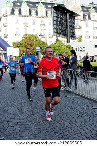 OSLO, NORWAY - SEPT 20: Unidentified marathon runners  at marathon on Sept 20, 2014 in Oslo, Norway - stock photo