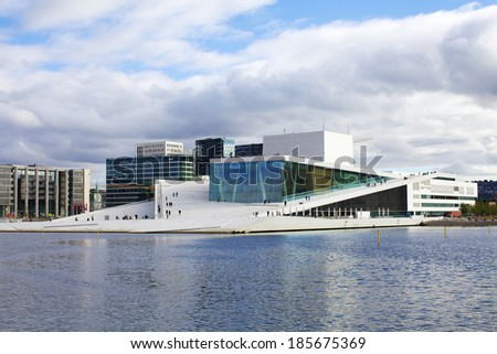 OSLO, NORWAY - SEPTEMBER 28: Oslo Opera house with great exterior is the home of the Norwegian National Opera and Ballet on September 28, 2013 in Oslo, Norway - stock photo