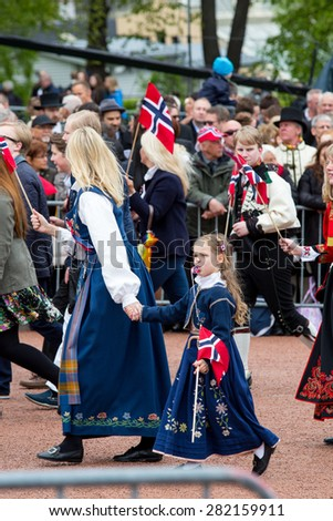 Oslo, Norway, 17th May 2015. The Norwegian Royal family greet groups of school children to celebrate the 17th May National Constitution day.  - stock photo