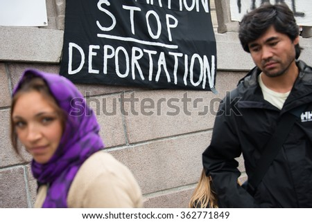 "OSLO - SEPTEMBER 12: A banner reads, ""Stop Deportation"", during a rally in support of Syrian refugees at the parliament building in Oslo, Norway, September 12, 2015. - stock photo"