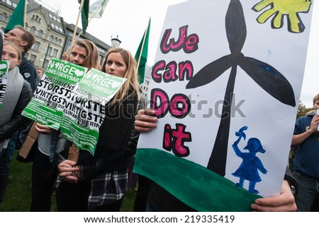"OSLO - SEPTEMBER 21: A sign reads, ""We Can Do It"", as thousands march through downtown Oslo, Norway, to support action on global climate change, September 21, 2014."