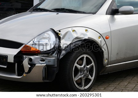 OSNABRUECK, GERMANY - circa May 2013:Damaged car, silver - stock photo
