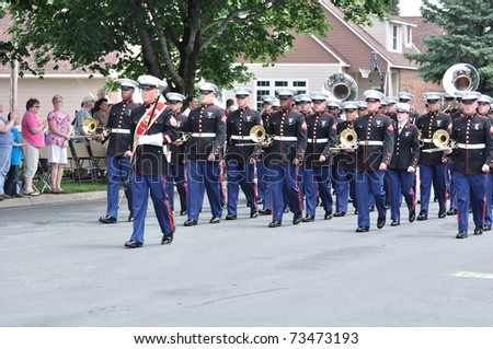 OSSEO, MN - JUNE 26 : The USMC Marine Forces Reserve Band Marching in the Osseo Marching Band Festival on June 26, 2010 in Osseo, MN - stock photo