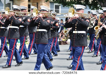 OSSEO, MN - JUNE 26 : The USMC Marine Forces Reserve Band Performing in the Osseo Marching Band Festival on June 26, 2010 in Osseo, MN - stock photo
