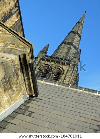 Ossett Church in winter looking up at the spire or steeple