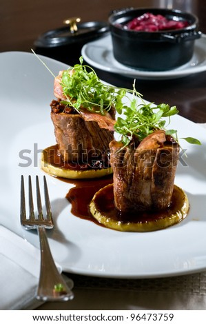 Osso buco over squash medallions covered in gravy - stock photo