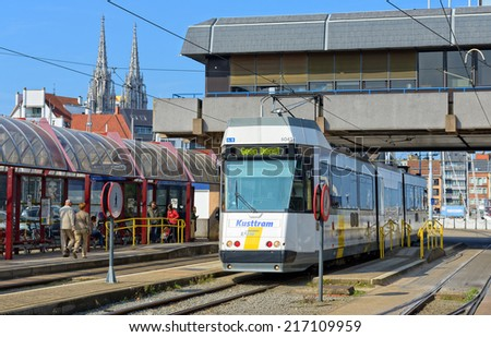 OSTEND, BELGIUM-SEPTEMBER 13, 2014: Kusttram or The Coast Tram at the Railway Station. The line serves to connect cities on entire coast of Belgium and is 68 km long. - stock photo
