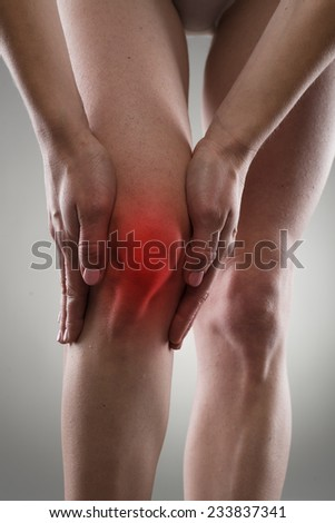 Osteoarthritis. Knee injury. Bone fracture. Female having sprain problems, holding her painful leg.  - stock photo