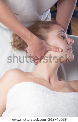 osteopath technique in the neck of a patient - stock photo