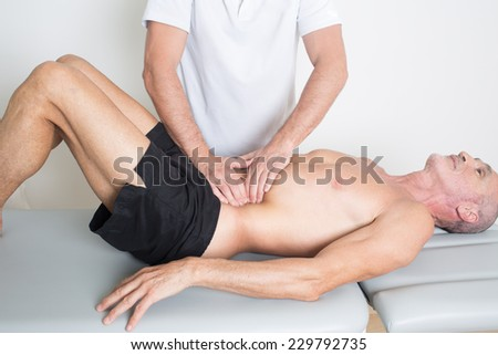 osteopathic medicine with older person - stock photo