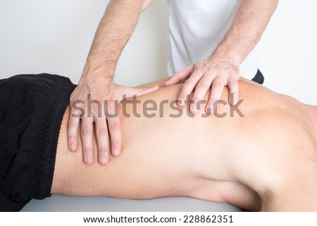 osteopathy on back of an middle-aged man - stock photo