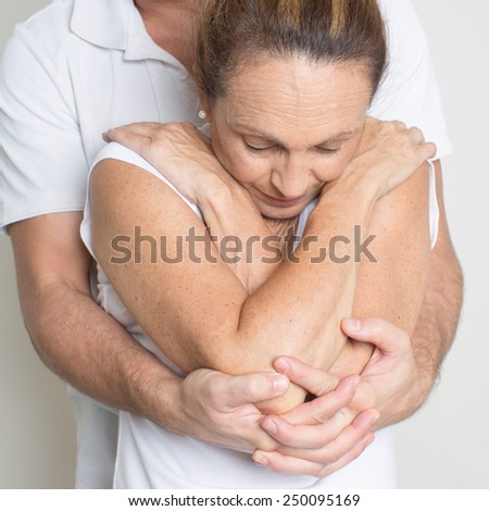 osteopathy with elderly woman - stock photo