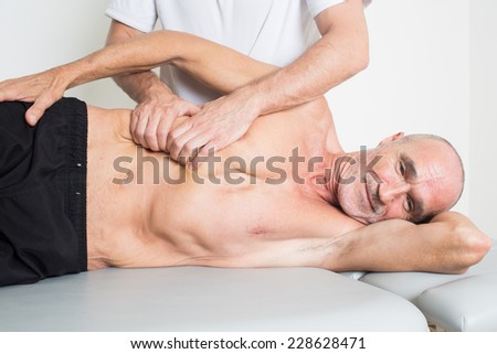osteopathy with senior - stock photo