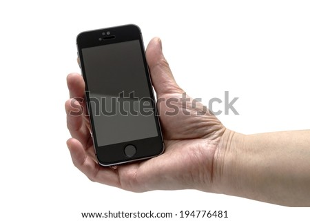Ostersund, Sweden - April 10, 2014: Hand holding black iphone 5s. Apple IPhone is one of the most popular smart phones in the world. - stock photo