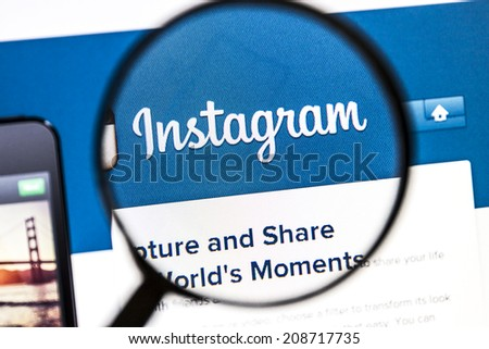 Ostersund, Sweden - August 3, 2014: Close up of instagram website under a magnifying glass. Instagram is an online mobile photo-sharing, video-sharing and social networking service. - stock photo
