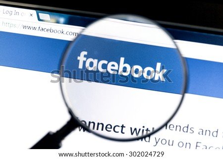 Ostersund, Sweden - August 1, 2015: Facebook website under a magnifying glass. Facebook is the most visited social network in the world - stock photo
