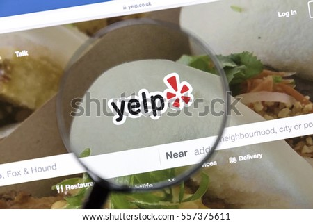 Ostersund, Sweden - Jan  16, 2017 Yelp website under a magnifying glass, Yelp is an American multinational corporation which publish crowd-sourced reviews about local businesses.