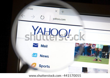 Ostersund, Sweden - June 23, 2016: Yahoo website under a magnifying glass. Yahoo is a multinational Internet corporation globally known for its Web portal, search engine Yahoo Search. - stock photo