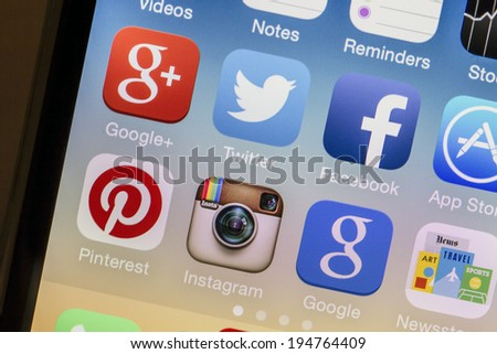 OSTERSUND, SWEDEN - MAY 25, 2014: Social media icons on Iphone 5s. Social media is the interaction among people in which they create, share or exchange information and ideas.  - stock photo