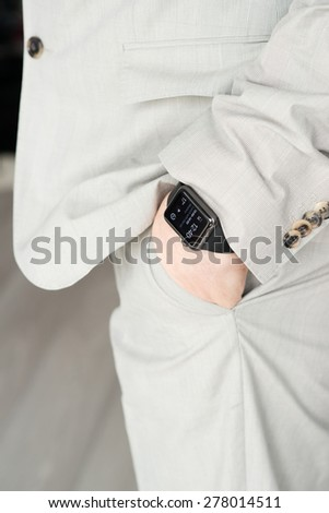 OSTFILDERN, GERMANY - MAY 14, 2015: A businessman is wearing the new Apple Watch, a black 42mm Apple Watch Sport. The Apple Watch is the latest device by computer and smartphone manufacturer Apple - stock photo