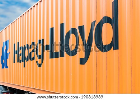 OSTFILDERN-SCHARNHAUSEN, GERMANY - MAY 1, 2014: A Hapag Lloyd container is waiting on a trailer to continue its travel after the public holiday on May, 1,2014 in Ostfildern-Scharnhausen, Germany. - stock photo