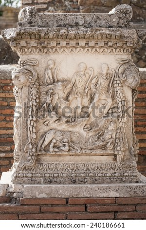 OSTIA ANTICA, ITALY - OCTOBER 28, 2014: A detail of a broken column in Ostia Antica.