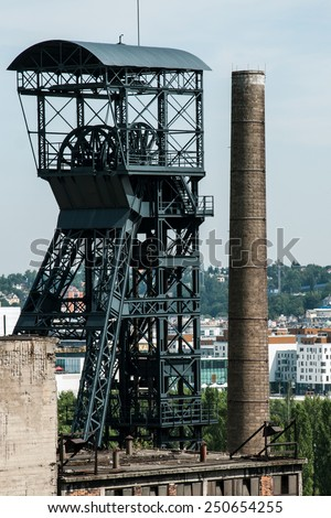 OSTRAVA, CZECH REPUBLIC, JULY 31, 2012 - Old coal mine shaft with mining tower and chimney - stock photo