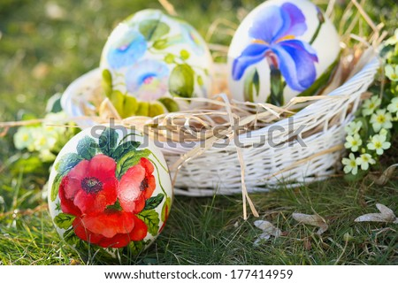 Ostrich painted eggs with flowers decoration . Easter and spring celebration - stock photo