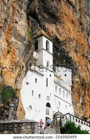 OSTROG, MONTENEGRO - AUG 07, 2009: Pilgrims and other visitors in the Ostrog Monastery, a Serbian Orthodox Monastery in Ostrog, Montenegro - stock photo