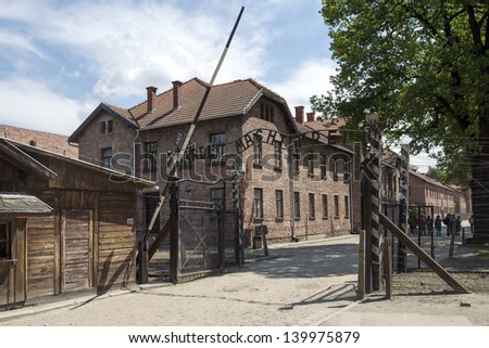 OSWIECIM - MAY 26: Gate at the entrance of in the concentration camp in Oswiecim, Poland on May 26, 2013. Oswiecim was the largest German concentration camp on Polish territory during World War II. - stock photo