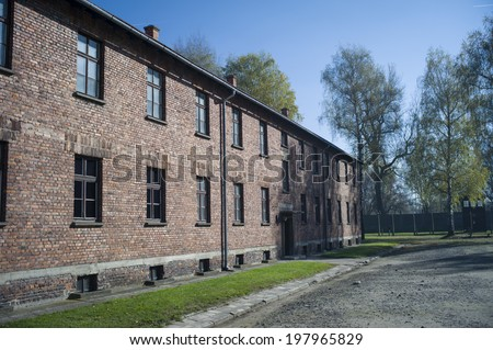 OSWIECIM - OCT 29: Buildings in the former German concentration camp in Oswiecim, Poland on October 29, 2013. Oswiecim was the largest German concentration camp in Poland during World War II. - stock photo