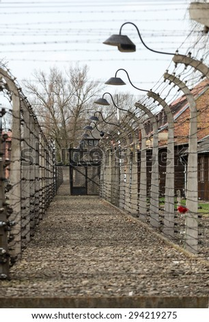 OSWIECIM, POLAND - APRIL 16, 2015: Electric fence in former Nazi concentration camp Auschwitz I, Poland - stock photo