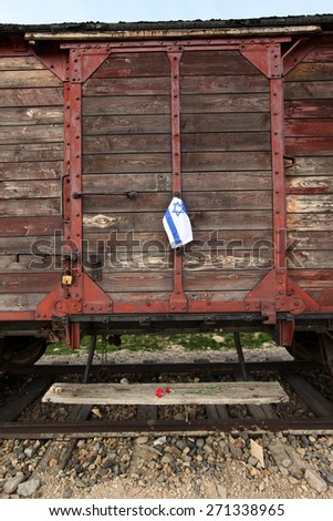 OSWIECIM, POLAND - APRIL 16, 2015: Holocaust Remembrance Day next generation of people from the all the world meets on the March of the Living in Nazi German death camp in Auschwitz Birkenau,in Poland - stock photo