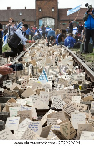 OSWIECIM, POLAND - APRIL 16, 2015: International Holocaust Remembrance Day . Annually people from the all the world meet on the March of the Living in german Concentration Camp in Auschwitz Birkenau - stock photo