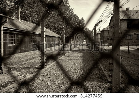OSWIECIM, POLAND - AUG 18: Electric fence in Nazi concentration camp Auschwitz I on August 18 2015 in Oswiecim, Poland.