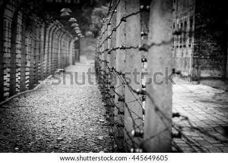 OSWIECIM, POLAND, FORMER GERMAN NAZI CONCENTRATION AND EXTERMINATION CAMP Auschwitz-Birkenau, June 11, 2016, fence with barbed wire