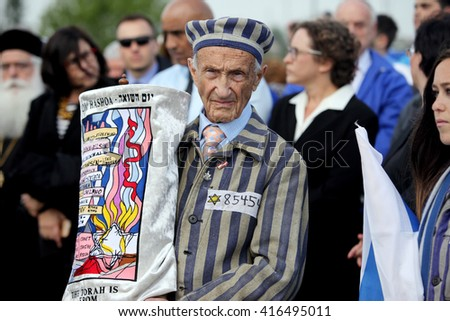 OSWIECIM, POLAND - MAY 5, 2016: International Holocaust Remembrance Day. People from the all the world meets on the March of the Living in german Concentration Camp in Auschwitz Birkenau.Poland