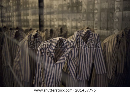 OSWIECIM, POLAND - OCT 29: The scary exhibition with prisoners clothes shown in the concentration camp of Auschwitz on October 29 2013 in Oswiecim, Poland. - stock photo