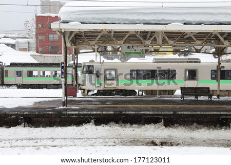 OTARU JAPAN - FEBRUARY 13 :   heavy snow  in Otaru train station in Sapporo , Japan  on February 13, 2014. This  snow storm has killed 19 people and caused more than 1,600 injured around the country