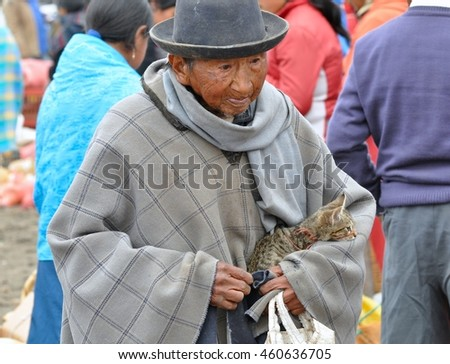 Otavalo, Ecuador-December 4, 2010: An old man walks with his kitten in the market